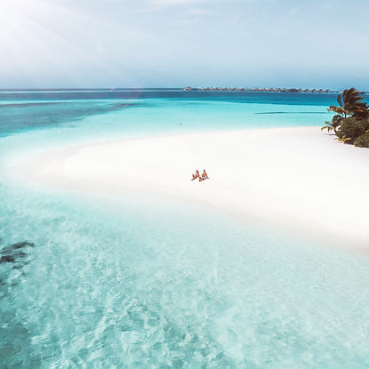 The Wanderlovers Angsana Velavaru Island Resort The Maldives Luxury Private sea plane beach drone aerial shot
