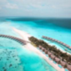 The Wanderlovers Maldives kuramathi resort drone shot island sandbar overwater villa