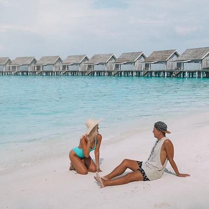 The Wanderlovers Maldives overwater villa couple retreat getaway private island resort kuramathi
