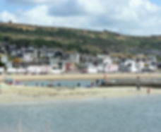An image of the seaside in Lyme Regis.