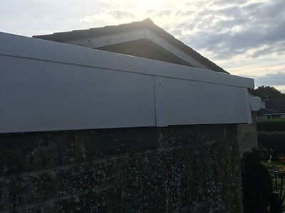 An image of a fascia board that's been cleaned using a water-fed pole and pure water. It looks like new.