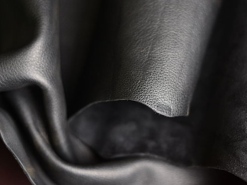 Premium Black Wornsaddle 5-5.5oz leather rolled to show pebble
