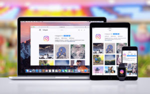 A laptop, tablet, and phone with Instagram opened.