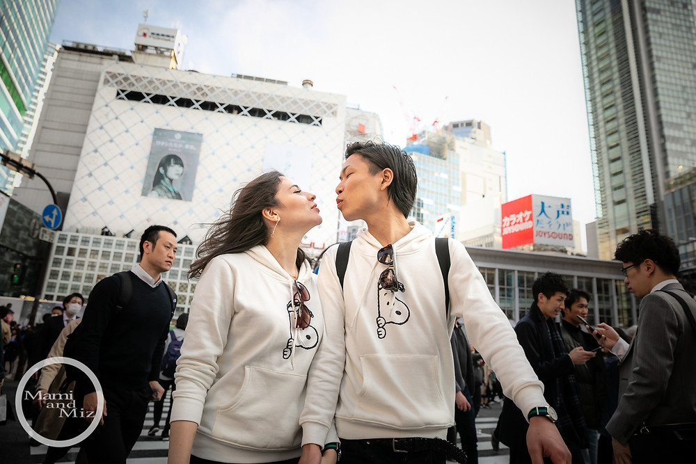 young couple kissing portrait in shibuya crossing intersection