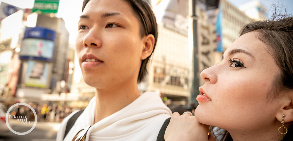 young couple portrait in shibuya crossing intersection 1