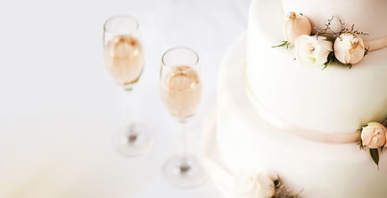 Wedding Cake With Pink Rosebuds And Champagne Flutes