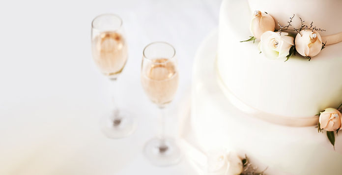 Wedding Cake And Champagne Flutes On Tab
