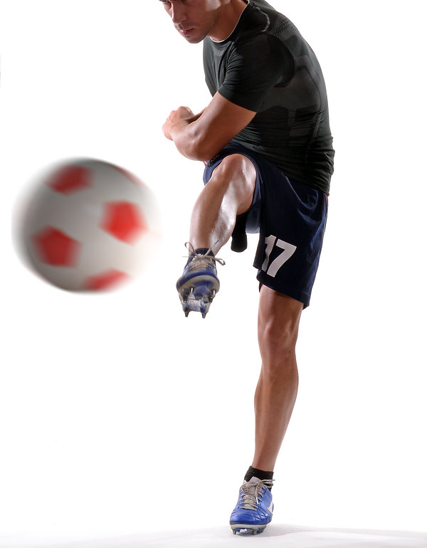 Soccer player kicking soccer ball..jpg