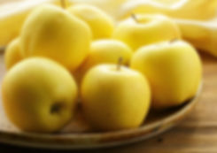 fresh autumn yellow apples on wooden tab