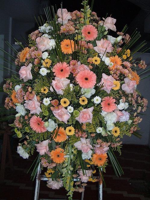 Coroa media com gerberas e rosas