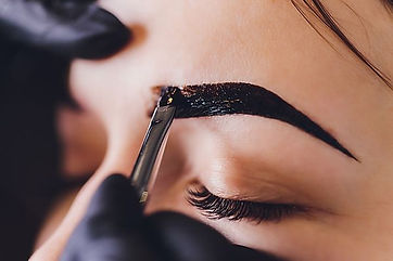 beautician- makeup artist applies paint