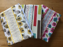 Book slip covers with hand smocked inserts