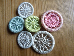 A selection of Dorset cross wheel buttons made at a workshop