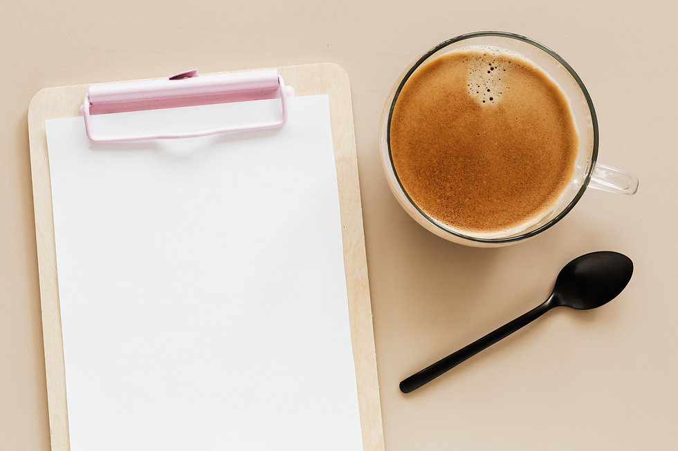 delicious-hot-coffee-and-clipboard-on-be