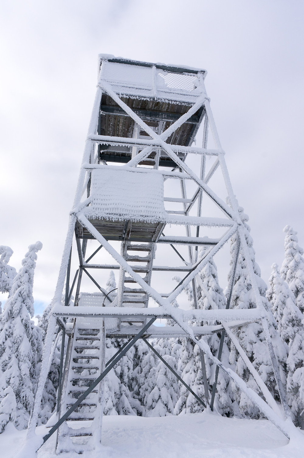 Snow-covered fire tower atop Bald Mountain in Rangeley, Maine.