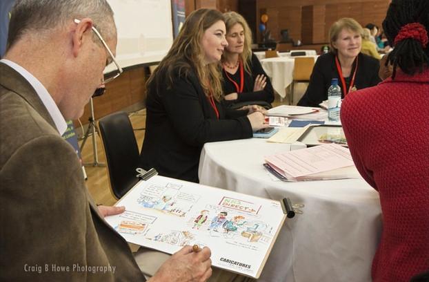 Luke Warm drawing Conference Cartoons at a Seminar Workshop