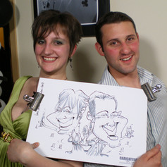 Luke Warm Caricaturing a Couple On the Spot at a Corporate Staff Party in Kent