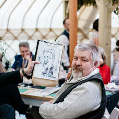 Caricature of a wedding guest drawn at the wedding breakfast in a yurt