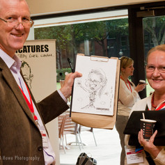 Luke Warm Caricaturing On the Spot at a Conference in London