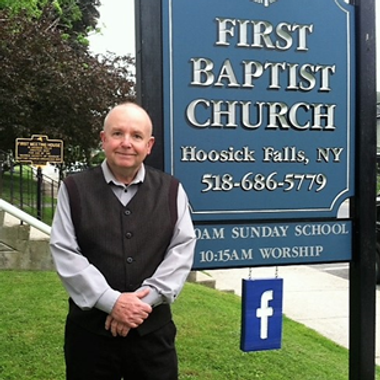 Pastor Dave by sign.png