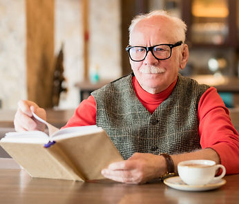 portrait-of-elderly-man-with-book-JKW9ZB