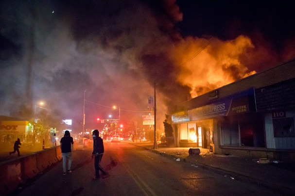 Lake Street and Nicollet Avenue on fire during the early morning hours in Minneapolis during the George Floyd protests and riots in 2020