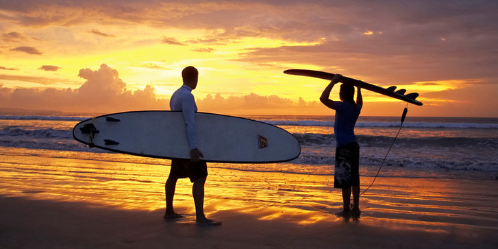 Surfers at Kuta Beach.  Bali, Indonesia