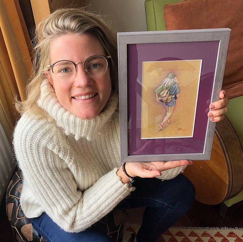 Annemarie with her pencil portrait, Emma Bijloos 2018