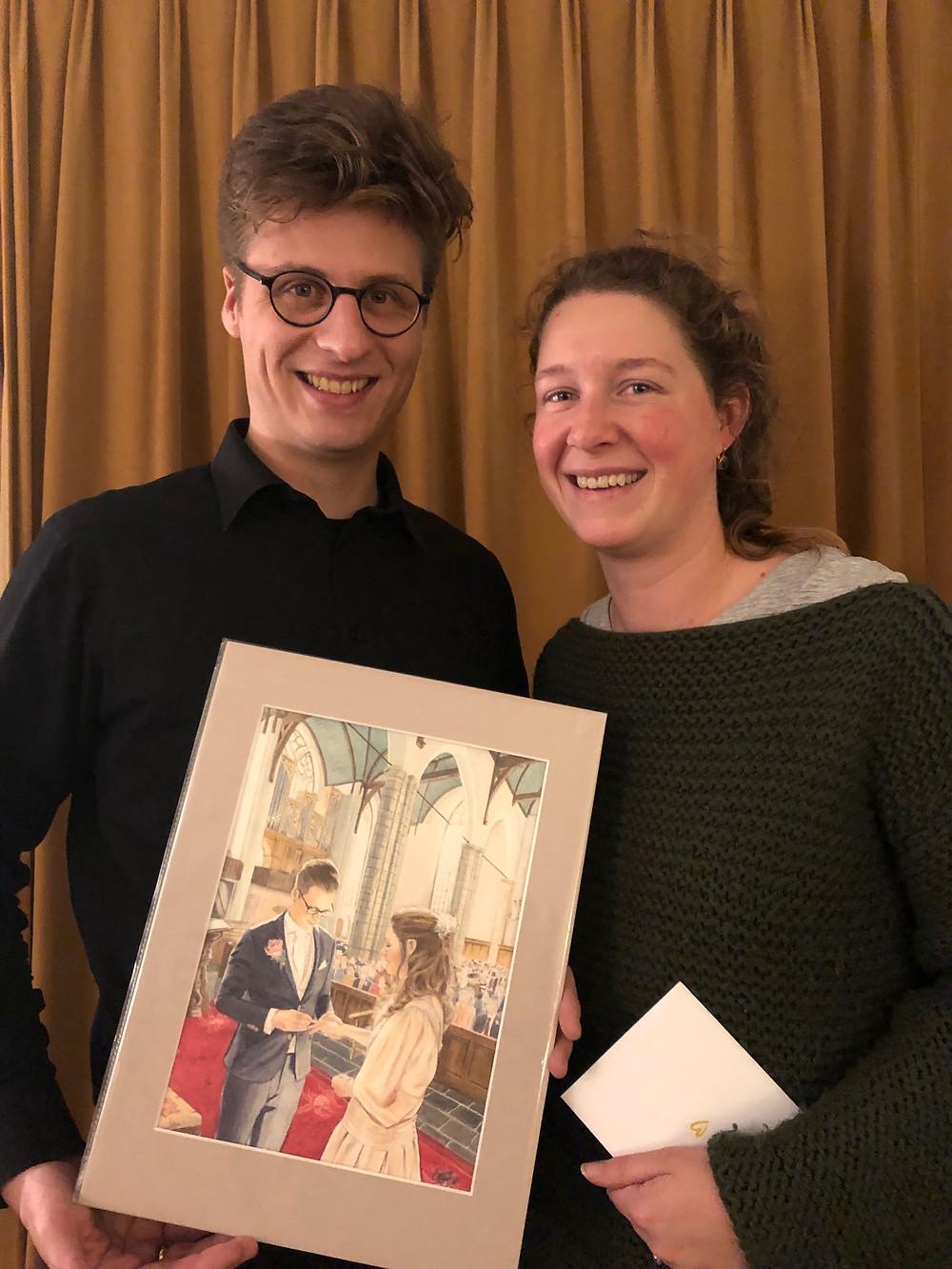 Gelukkig echtpaar met op maat gemaakt schilderij