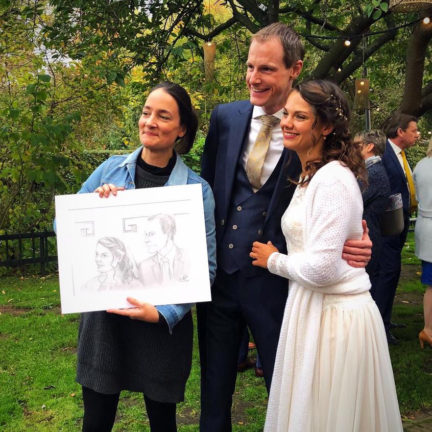 Jill & Sebas with their wedding portrait, Emma Bijloos 2018