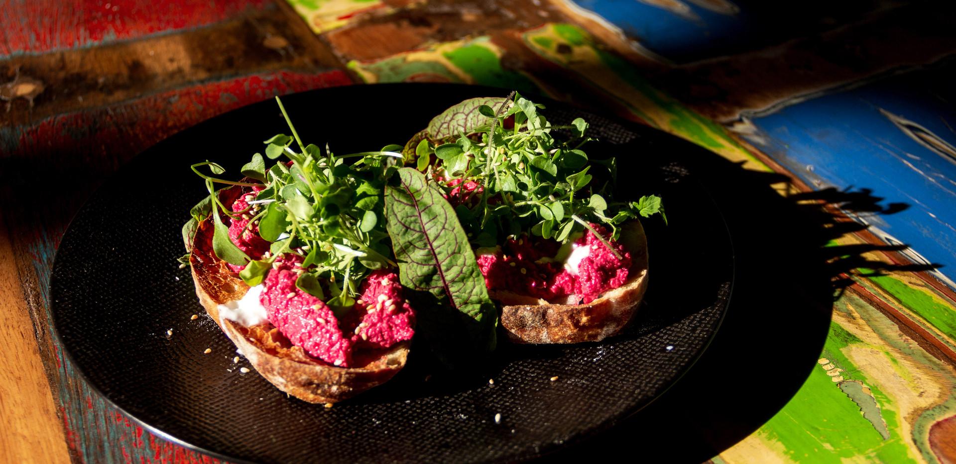 Breakfast: Beetroot-Hummus on sourdough bread with mustard microgreens