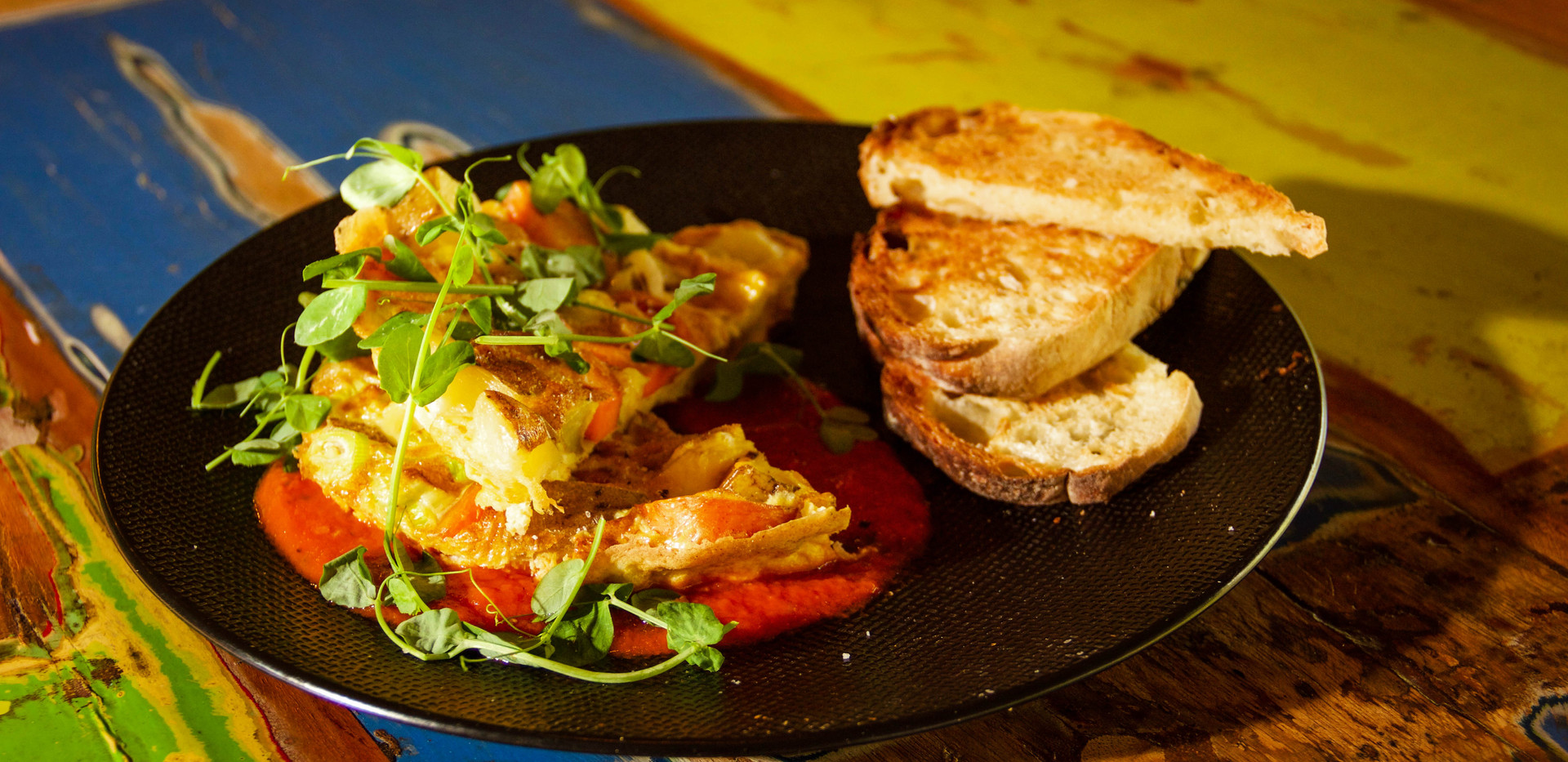 Breakfast: Vegetable Omelette with peashoots and sourdough bread