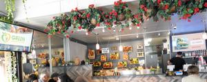Green Bakery Cafe using digital displays