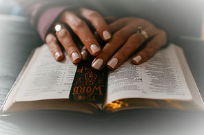 Woman's%20hands%20on%20top%20of%20Bible%