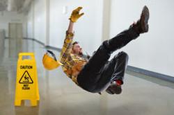 worker-falling-wet-floor-inside-building-71158350
