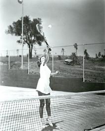 Barbara Stanwyck playing tennis at Marwyck Ranch The Oakridge Estate Paul R. Williams