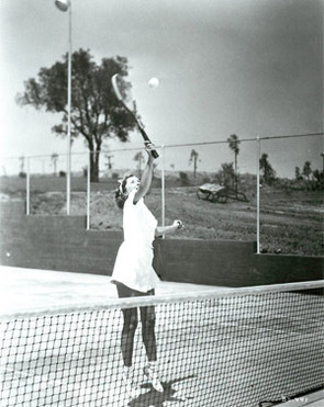 Barbara Stanwyck playing tennis at Marwyck Ranch The Oakridge Estate Paul R. Williams