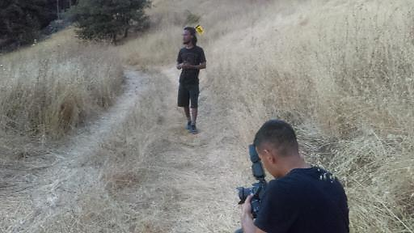 Feq'ad shooting a music video with Tobi.