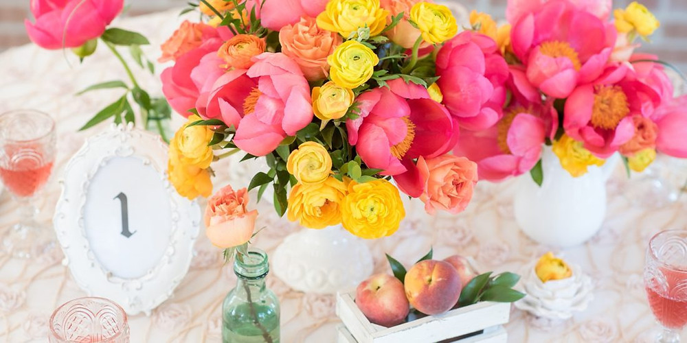 Coral and yellow ranunculus, peony, and rose wedding, table arranement