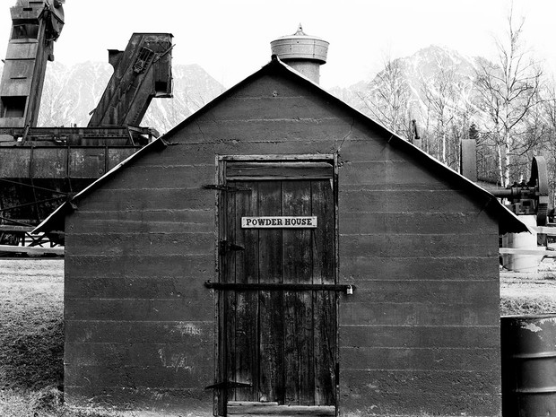 Coal discovery in the Sutton and Chickaloon areas of the early 1900s meant the need for power for mining machinery and the building of roads.    The Powder House, built in 1921, housed explosives for coal mining operations and construction of the Glenn Highway.    Chamonix 045N-2, 210mm Caltar II-N, Ilford HP5+.