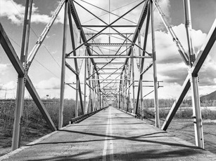 The first bridge built where the Old Glenn Highway crosses the glacial-fed Knik River near Butte. A new bridge was constructed in 1976 and remains in service today.    Calumet Wood Field 4×5, 90mm Schneider Super-Angulon, Kodak TMax 400.