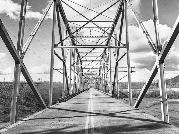 The first bridge built where the Old Glenn Highway crosses the glacial-fed Knik River near Butte. A new bridge was constructed in 1976 and remains in service today.    Nagaoka Wood Field 4×5, 90mm Schneider Super-Angulon, Kodak TMax 400.