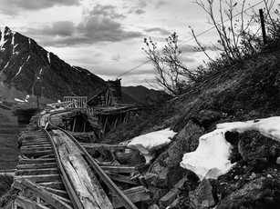 Nestled nearly 3,500 ft. in the Talkeetna Mountains, a portion of the tramway used to carry ore still stands above the old mill at the Independence Mine Complex in southcentral Alaska.  Mamiya RB67 Pro-SD, 90mm Sekor C, Fuji Acros.