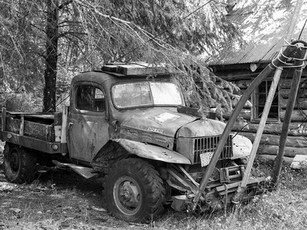 This remnant of days long past sits idle outside an old barn in the former mining district of Hope, Alaska.  Chamonix 045N-2, 210mm Caltar II-N, Arista EDU 200.