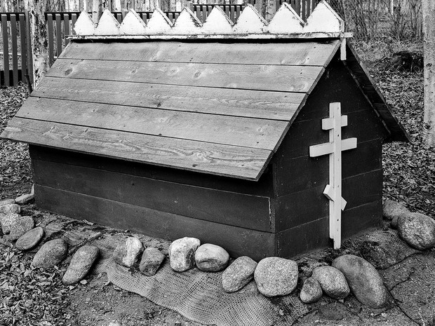 The gravesite of Ahtna Athabascan John Goodlataw (1870-1935), who settled in Chickaloon during the coal mining days, is located in Sutton at the Alpine Historical Park.  Chamonix 045N-2, 210mm Caltar II-N, Ilford HP5+.
