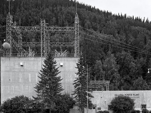 The New Eklutna Power Plant, located 30 miles northeast of Anchorage along the Knik River, was jointly owned with Municipal Light & Power and Matanuska Electric Association. It was funded and built by the Department of the Interior's Bureau of Reclamation, several miles upriver from the original 1920s power plant.  A 4.5 mile long tunnel was bored through East Twin Peak to provide water for the New Eklutna Power Plant. Drilling the nine foot diameter tunnel from both the Knik River side and the Eklutna Lake side began in 1951 and connected in October, 1953, which was a marvelous engineering feat for its day.  Dedicated on August 29, 1955, the Eklutna Project provided 33,000 kW to the city of Anchorage, the military bases of Fort Richardson and Elmendorf Air Force Base, and communities in the Matanuska-Susitna Borough.  As it is with modernization, an even newer plant, owned by the Matanuska Electric Association, was built just 5 miles upstream from it in 2015.   Afga Ansco Type C-1 8x10 Ground Camera, 240mm Fujinon, Ilford HP5+.
