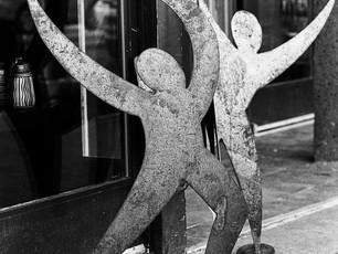 Dancing in the street.  Nikon F5, 50mm Nikkor, Kodak TMax 400.