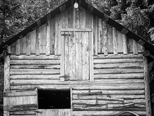 """""""Miner's Barn."""" - Hope, Alaska. The gold rush of the 1890's brought prospectors and the need for supplies to the small towns of Hope and Sunrise. Local stores sold food, clothes, tents, and mining supplies. Saloons, hotels, and roadhouses provided relaxation to miners after hard days afield. This old barn is one of several original buildings still standing today.  Chamonix 045N-2, 150mm Schneider-Kreuznach Xenar, Arista EDU 200."""