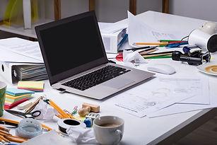 messy-desk-laptop-computer.jpg