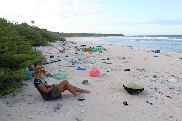 Alice Forrest sitting on plastic polluted beach - Henderson Island